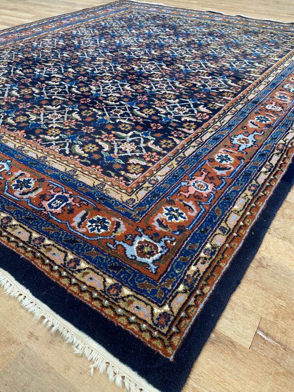 Herati tapijt vloerkleed perzisch pers handgeknoopt marineblauw bruin limburg vintage roermond perzisch tapijt