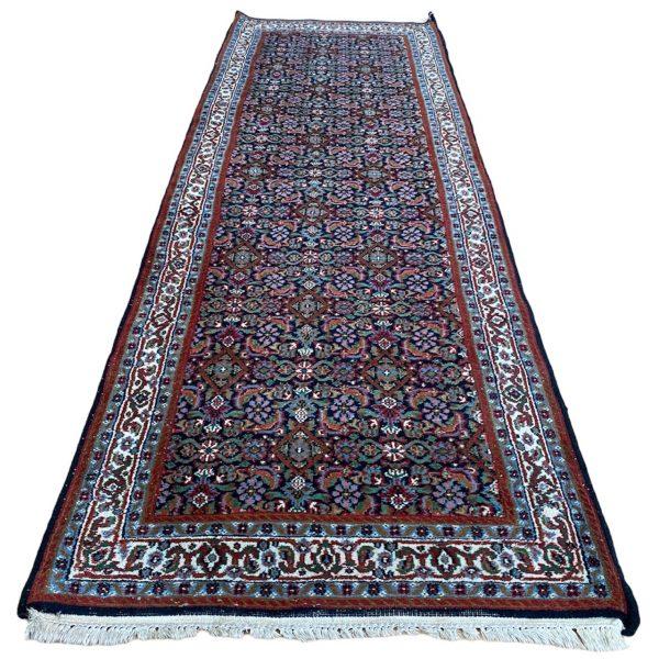 perzische loper wol blauw zwart handgeknoopt persian rug vintage tapijt limburg